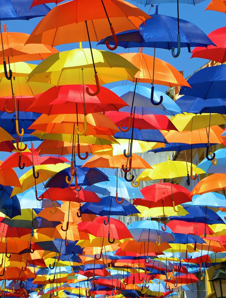 Colorful Umbrellas Floating in the Streets in Portugal