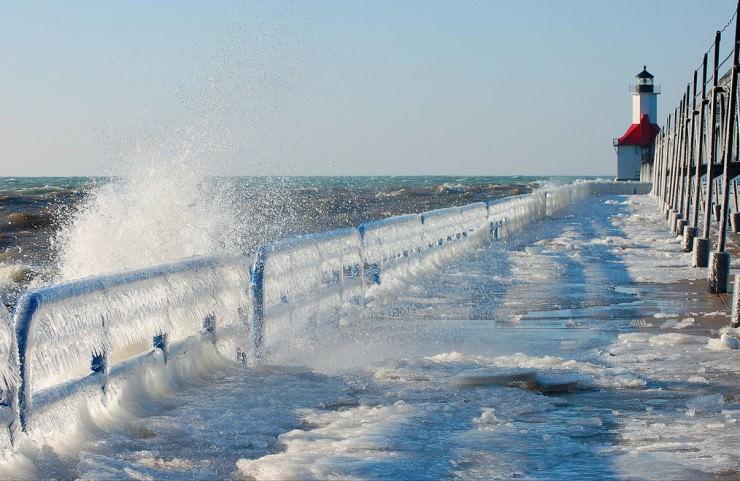 Frozen St. Joseph North Pier on Lake Michigan, USA