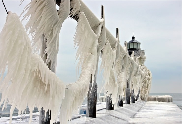 Frozen St. Joseph North Pier on Lake Michigan, USA