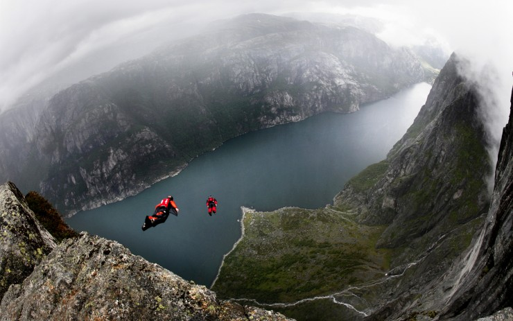 BASE jumping in Kjerag. The annual Heliboogie were participants have the option of being flown to the top of the Kjerag mountain with a helicopter, and jump off with their parachute.
