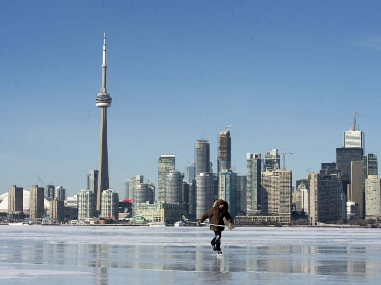 TORONTO, ONTARIO: January 3, 2014-- ISLAND SKATE -- Tyler Hnatuk skates the frozen Toronto Harbor just off Algonquin Island with the city of Toronto in the background, Friday January 3, 2014. [Peter J. Thompson/National Post] [For Toronto story by Peter Kuitenbrower/Toronto] //NATIONAL POST STAFF PHOTO