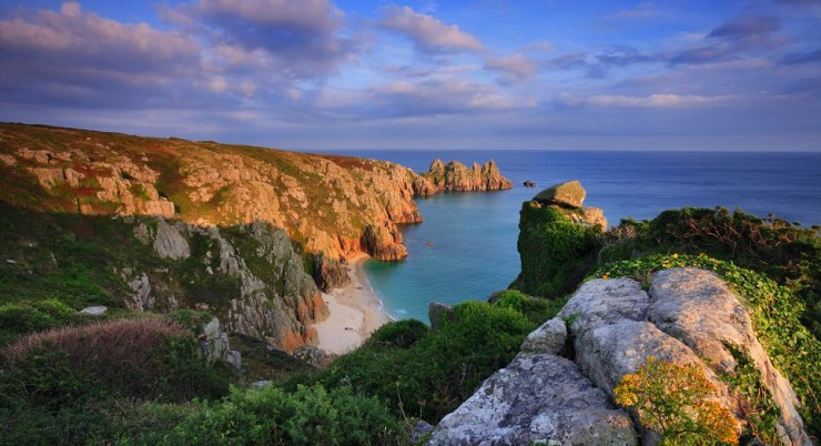 United Kingdom, UK, England, Cornwall, Penwith peninsula, Great Britain, Travel Destination, Coastal landscape near Porthcurno, with the National Trust owned Logan Rock, one of the iconic rock formations of Cornwall's Land's End Peninsula, in the background