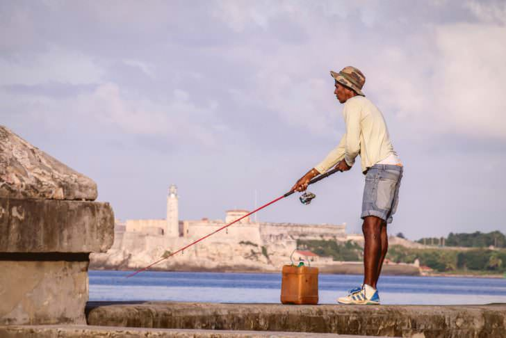 Fisherman with rod on Malecon