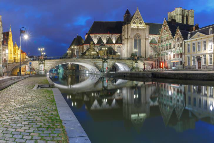 St Michael's Bridge and church at night in Ghent, Belgium