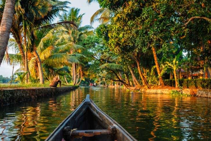 Kerala backwaters tourism travel in canoe boat, India