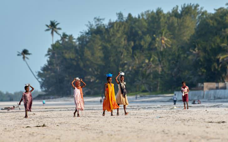 Local children walking on the beach in Jambiani, Zanzibar