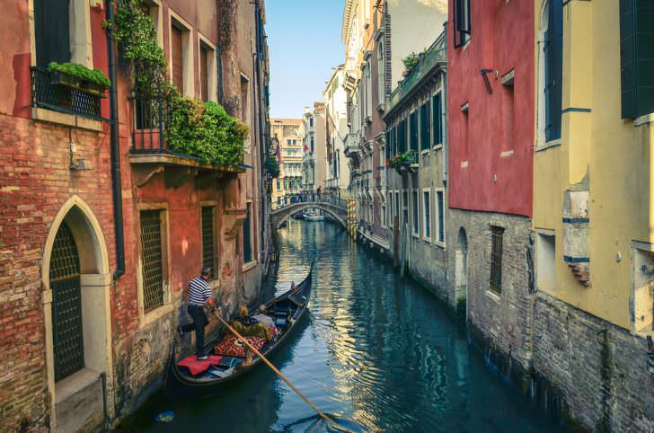 The venetian canals with gondola across the canal