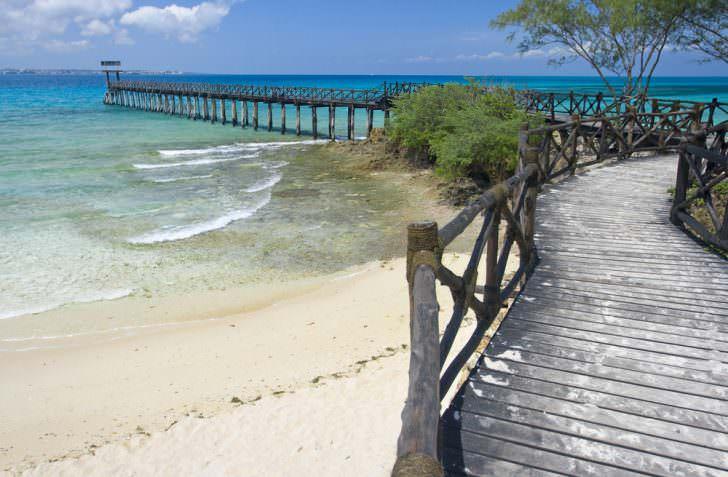 A part of beach with wooden mole on Prison island, Zanzibar