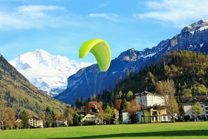 Man play para motor flying down in a garden, Interlaken, Switzerland