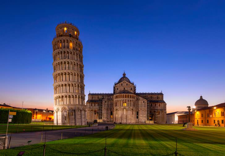 Night view of Pisa Cathedral with Leaning Tower of Pisa on Piazza dei Miracoli in Pisa, Tuscany, Italy