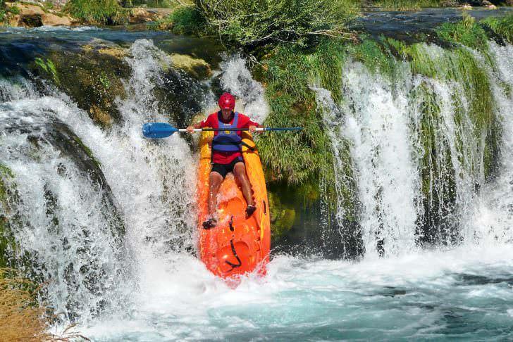 Croatia kayaker over a waterfall