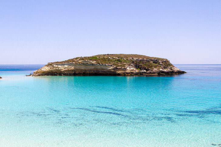 Pure crystalline water surface around an island Lampedusa