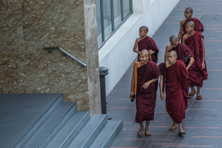 Young monks exploring downtown