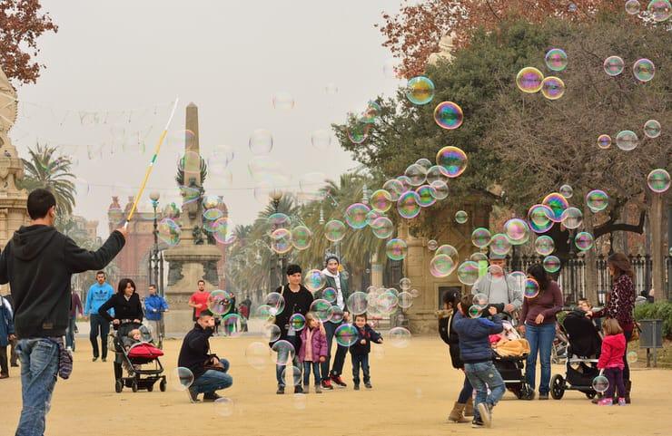 Children enjoy soap bubbles within Ciudadela Park, Barcelona