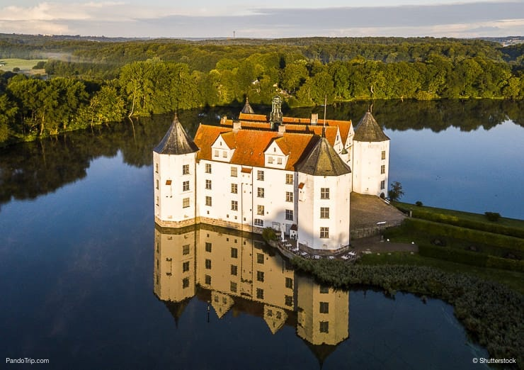 Aerial Drone View of Glucksburg water castle at dawn, Germany