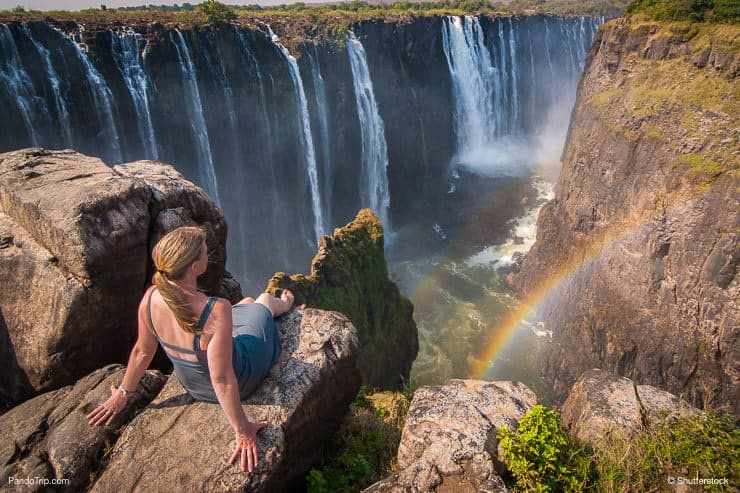 Girl looking at Victoria Falls