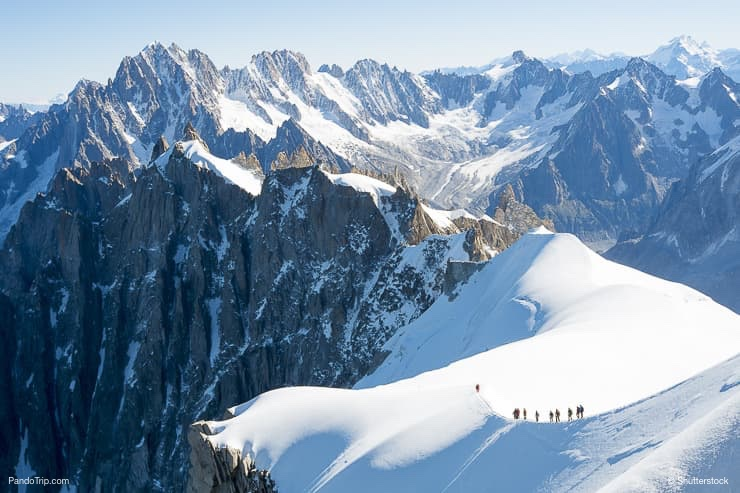 Mont Blanc mountaneers walking on snowy ridge