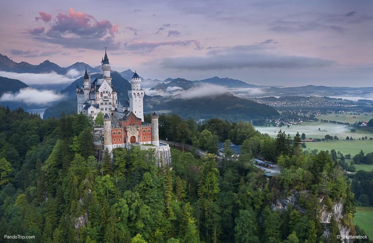 Neuschwanstein Castle during foggy summer morning
