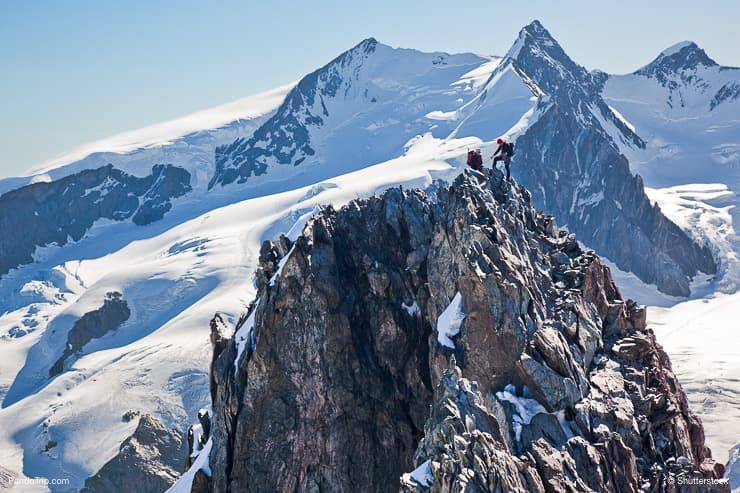 Two mountaineers climb the ridge of Breithorn in Monte Rosa massif