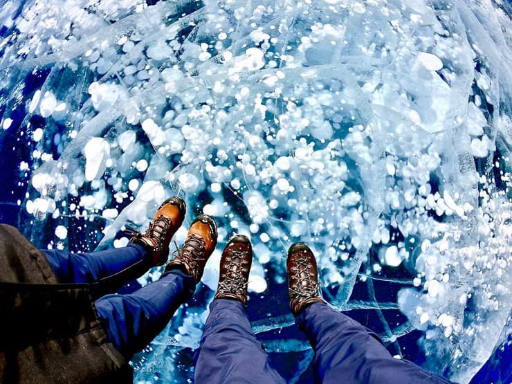 Standing on ice bubbles Abraham Lake