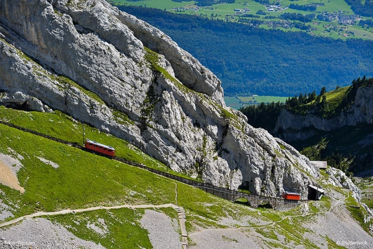 The two red Pilatus train, the world's steepest cogwheel railway nears the top of Mount Pilatus