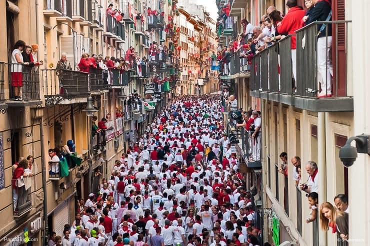 Bull running in the calle Estafeta in Pamplona, Spain