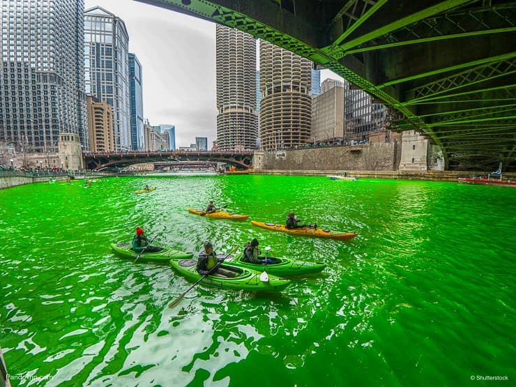 Kayaks and dyed green river in downtown Chicago during the St. Patricks Day celebration
