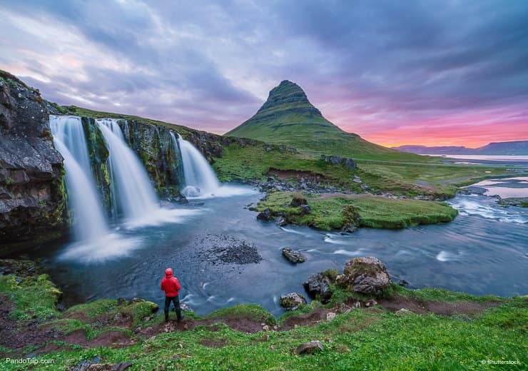 Kirkjufellsfoss waterfall and Kirkjufell mountain in Iceland