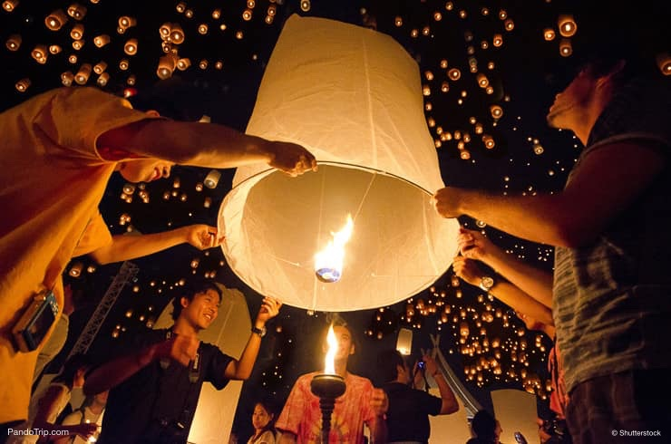 People are launching sky lanterns during Yi Peng and Loy Krathong festivals