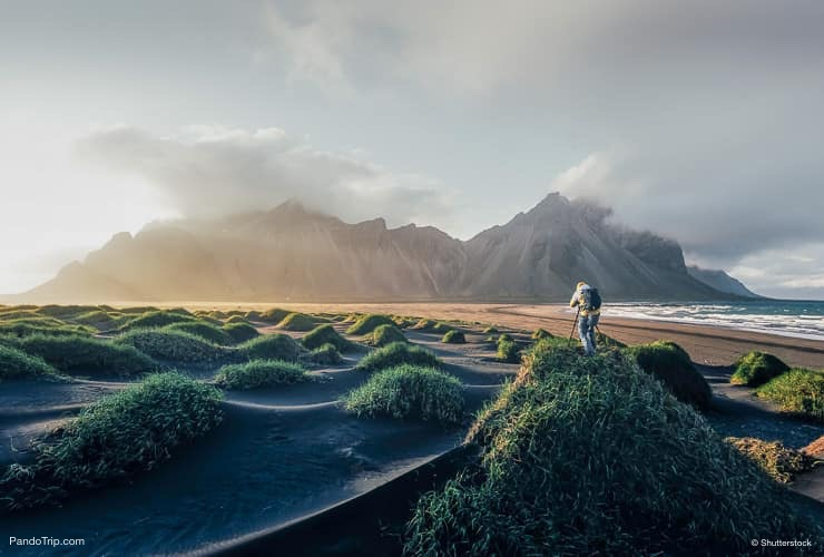 Photographer taking photo of famous Vestrahorn Mountain