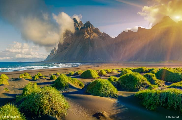 View of green dunes on the Stokksnes headland with Vestrahorn mountain on background