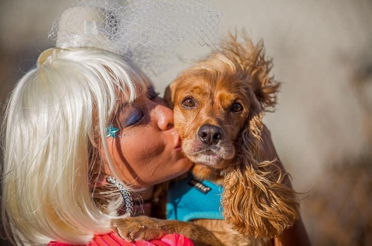 Girls kisses a dog at Burning Man Festival