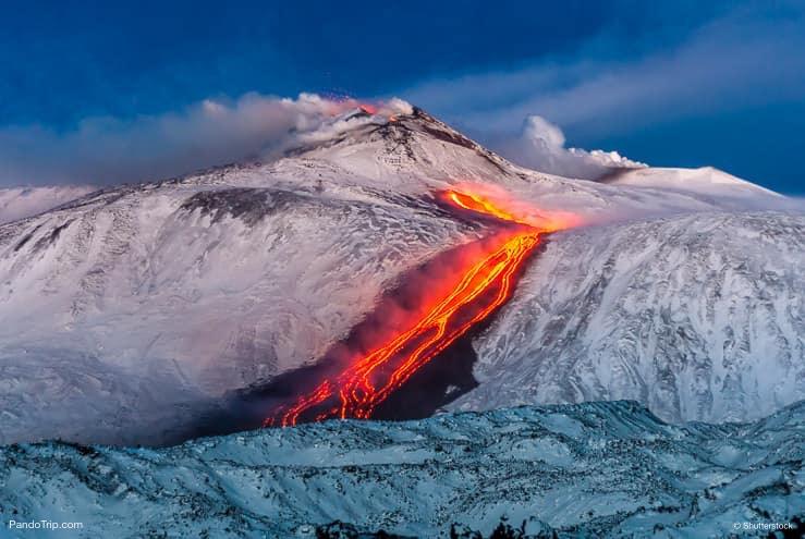 Etna Eruption. Lava flow through the snow. Sicily, Italy
