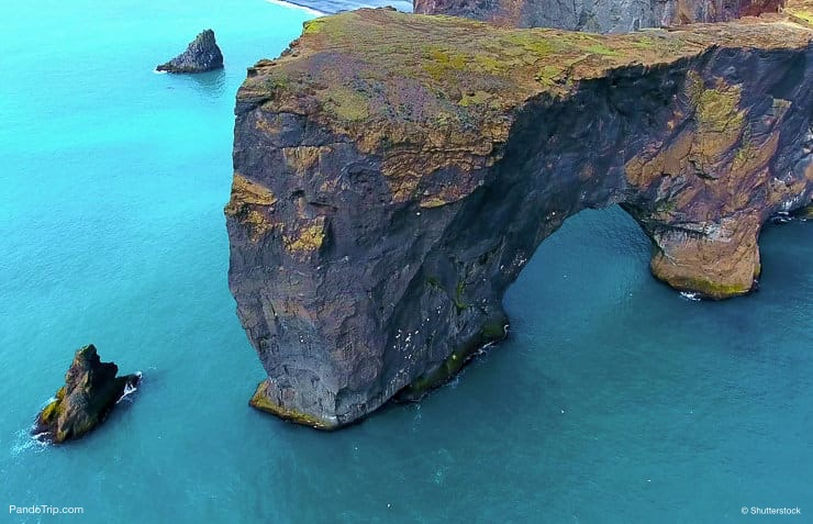 Huge Sea Arch In Turquoise Blue Ocean. Dyrholaey Sea Arch in Iceland