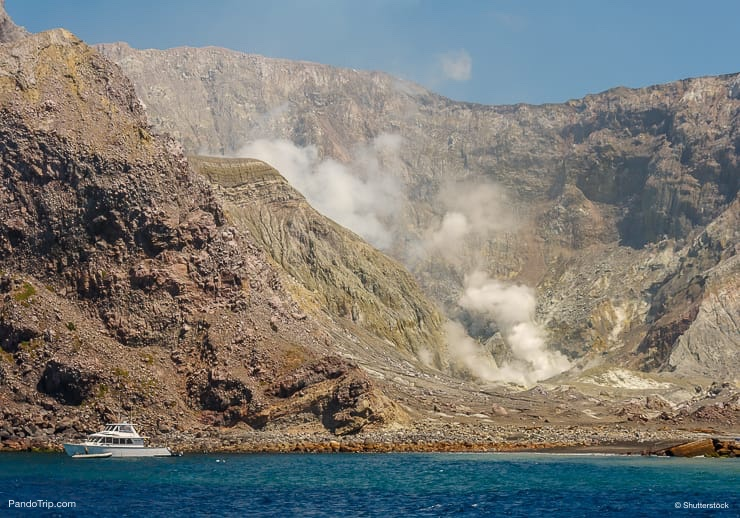 Yacht moored at Whakaari or White Island in New Zealand