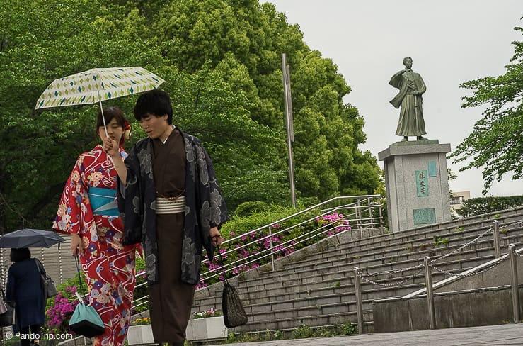 A couple walking at Sumida Park