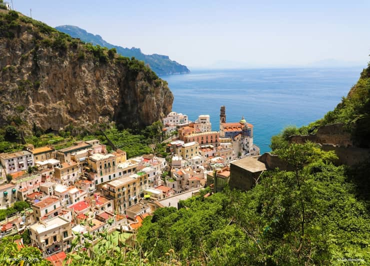Aerial view of Atrani village between green branches and cliff rocks, Amalfi Coast, Italy