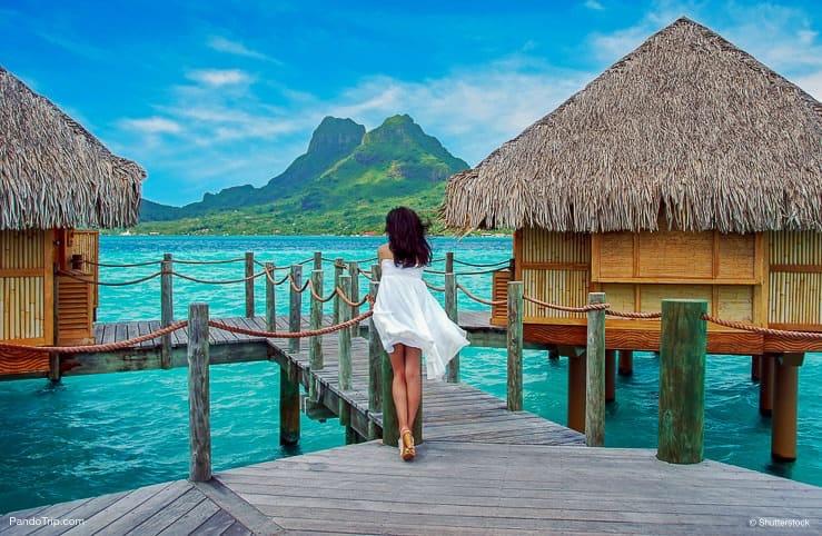 Beautiful Woman look towards to the Otemanu mountain in Bora Bora island, French Polynesia, Pacific ocean