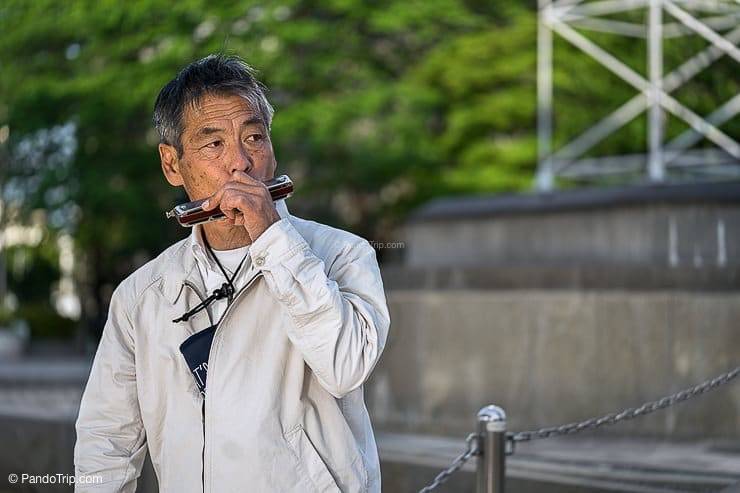 Japanese Man playing harmonica at Sumida Park