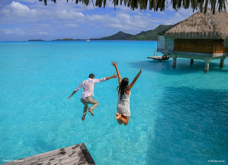 Jumping in the water in Bora Bora, French Polynesia, Pacific Ocean