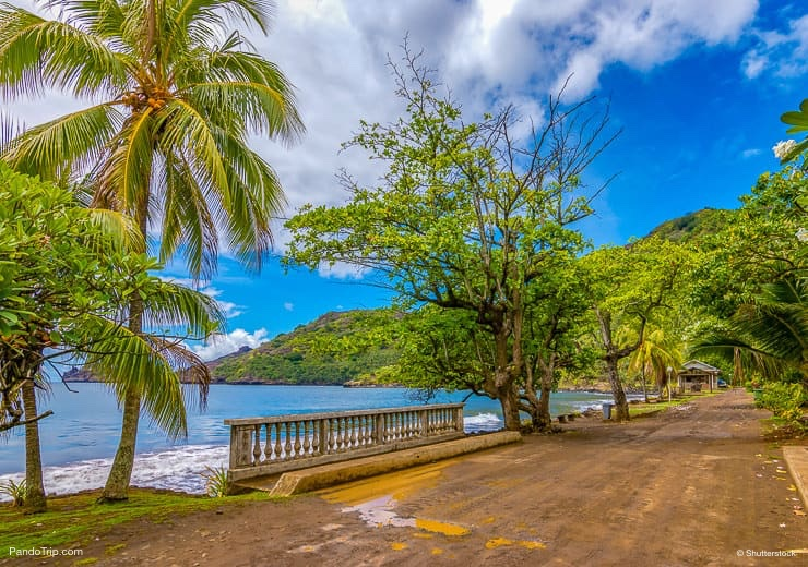 Muddy road at the ocean on Nuku Hiva, Marquesas Islands, French Polynesia