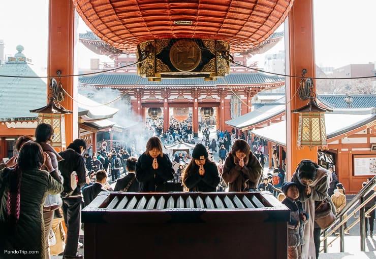 Praying at Senso-ji in Asakusa, Tokyo, Japan