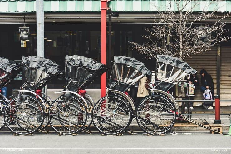 Row of Japanese rickshaws parking at the sidewalk on Asakusa road