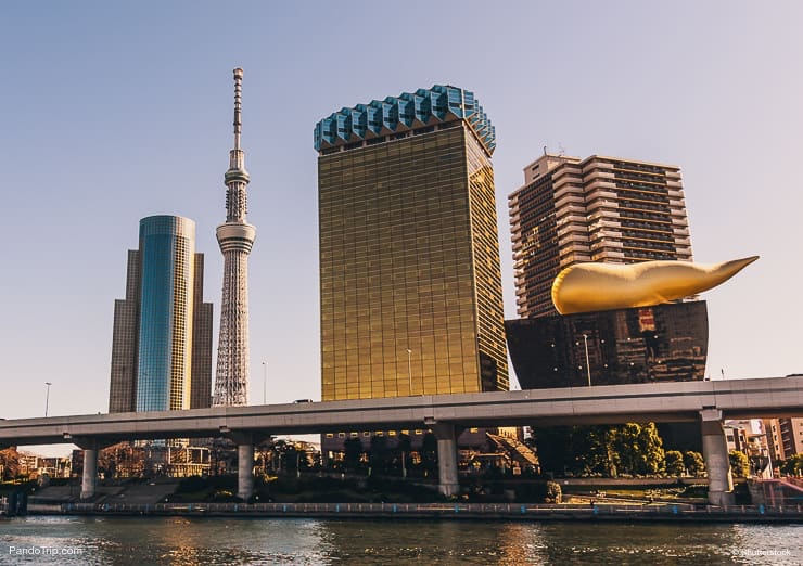 View of the Tokyo Skytree and the Asahi Beer Hall from across Sumida river