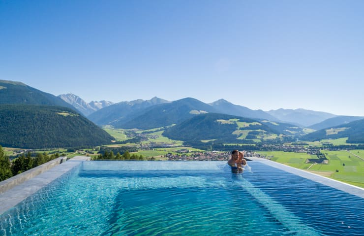 Amazing view from pool at Aerial view of infinity poll at Alpin Panorama Hotel Hubertus, Italy