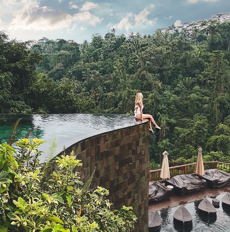 Beautifull woman and pool. Ubud Hanging Gardens, Bali, Indonesiajpg