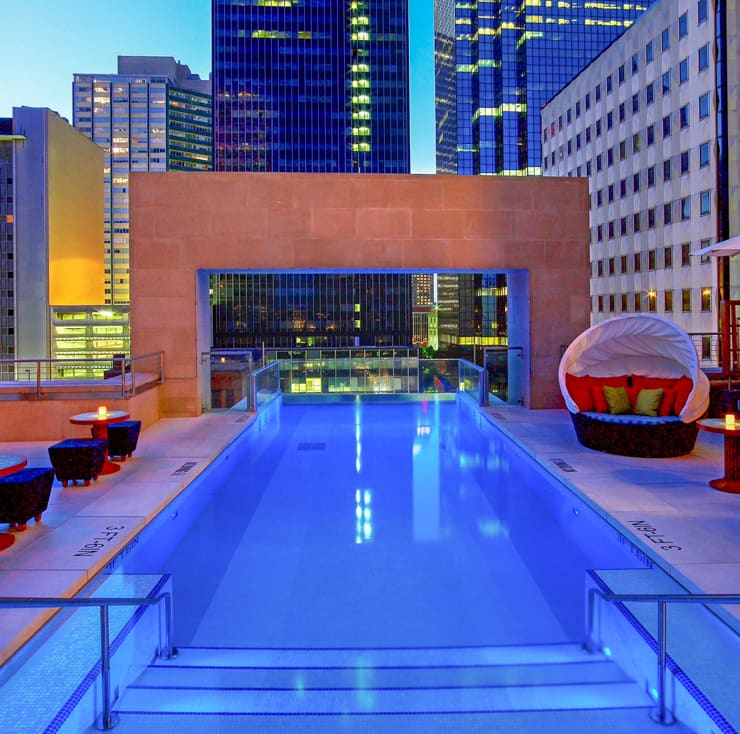 Glass-fronted rooftop pool in Dallas at night