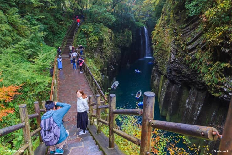People are taking a photo at Takachiho Gorge, Japan