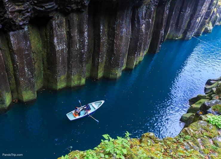 People in a rowing boat. Takachiho Gorge, Japan