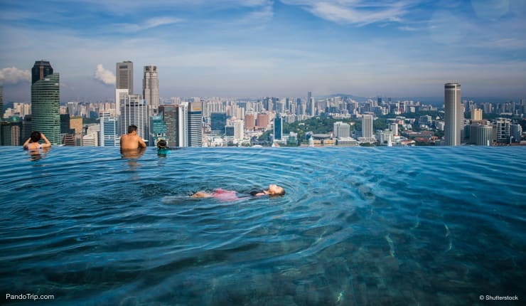 Swimming in rooftop infinity pool at the Marina Bay Sands Hotel in Singapore